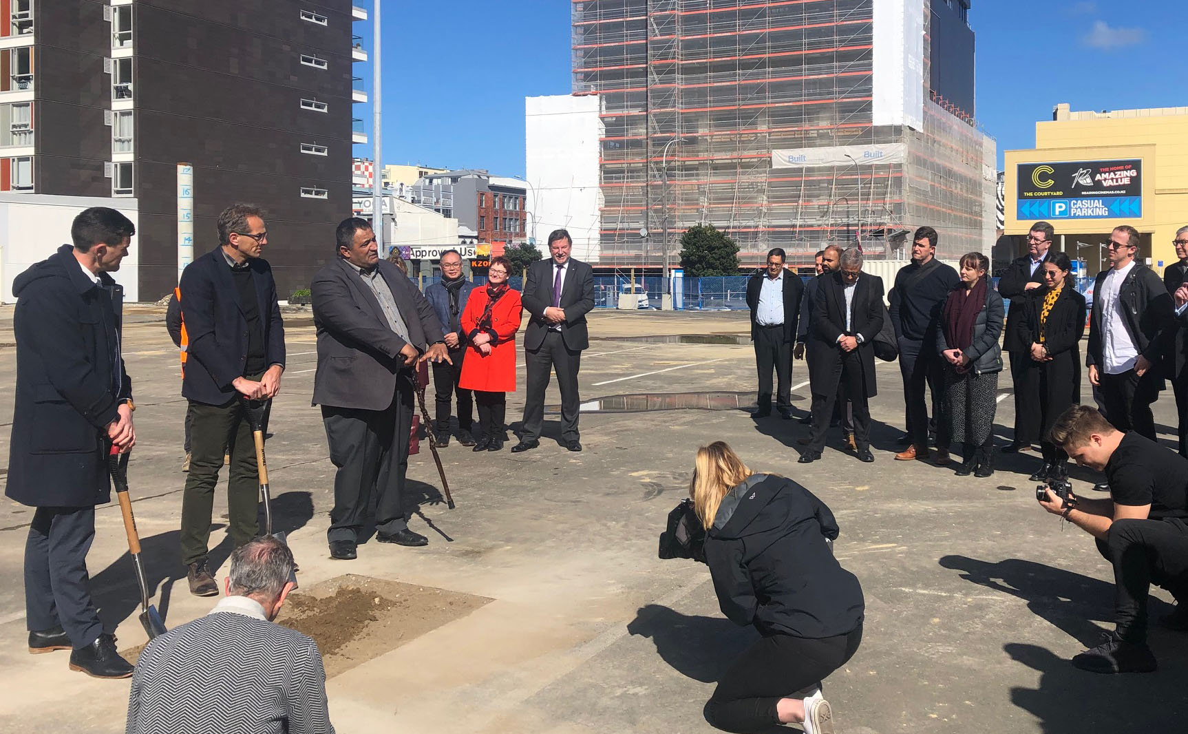Mayor Justin Lester, David Perks (General Manager of WellingtonNZ) and Kura Moeahu of Te Āti Awa speak and break ground at the site of the new Wellington Convention and Exhibition Centre